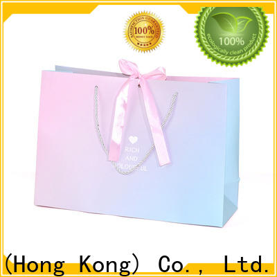 Welm waterproof striped paper bags wholesale for shopping